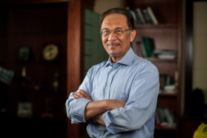 Anwar Ibrahim, Malaysia's opposition leader, poses for a photograph in Petaling Jaya, Selangor, Malaysia, on Tuesday, Feb. 19, 2013. Anwar, who was jailed for corruption and sodomy, predicted a smooth transition when his coalition ousts the government that has ruled Malaysia for 55 years in elections that may be held within weeks. Photographer: Sanjit Das/Bloomberg *** Local Caption *** Anwar Ibrahim